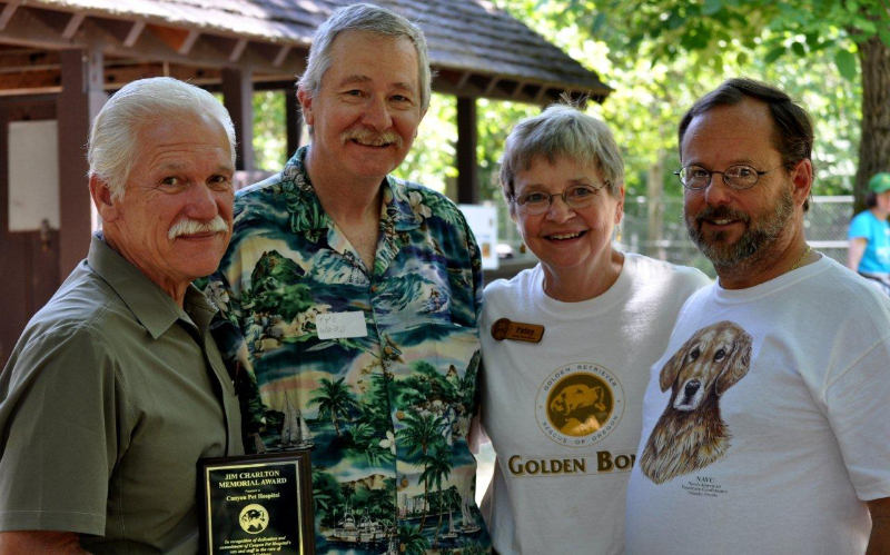 Receiving the Jim Charlton Memorial Award from Golden Bond Rescue: Dr. Bill Hughes, Dr. Tye Wood, Patsy Nolte of Golden Bond  Rescue and Dr Bill Baucum
