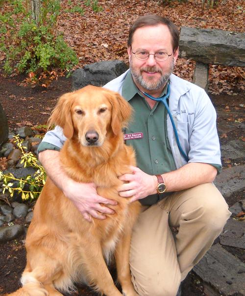 Dr. Bill Baucum with his golden retriever Hops
