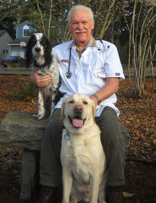 Dr. Bill Hughes with his dogs Bandit and Jackson